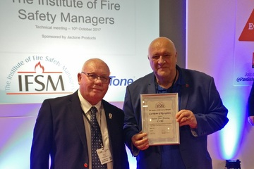 Graham Holloway receives certificate of recognition from the IFSM